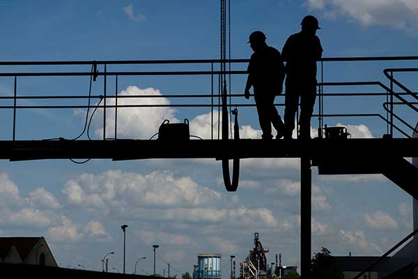 Construction workers on a Plant Access platform
