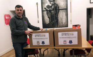 Ian Byrne of Fans Supporting Food Banks Accepting Heightsafe's Donation