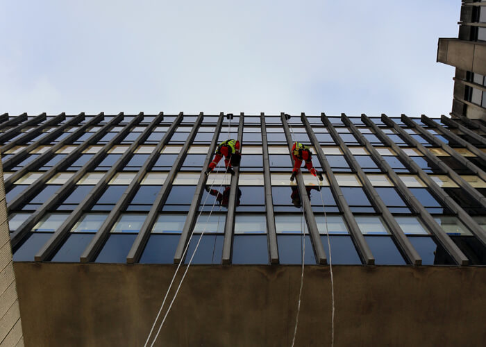 Rope Access Technicians Abseiling Down Facade