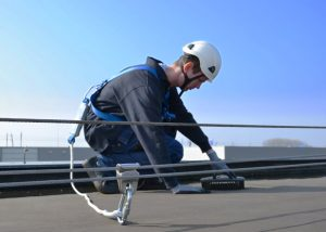 Man Working at Height Safely whilst attached to a specialist personal fall protection Safety Line
