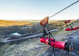 People zip wiring down mountain