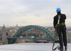 Man attached to Fall Protection System