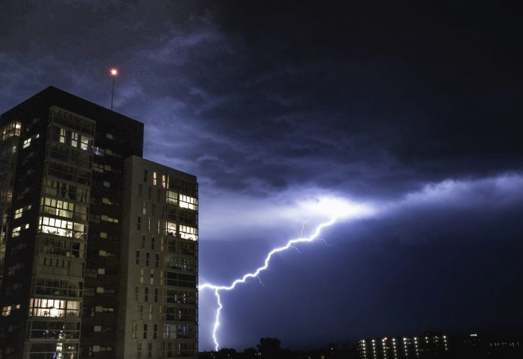 Lightning next to high rise building