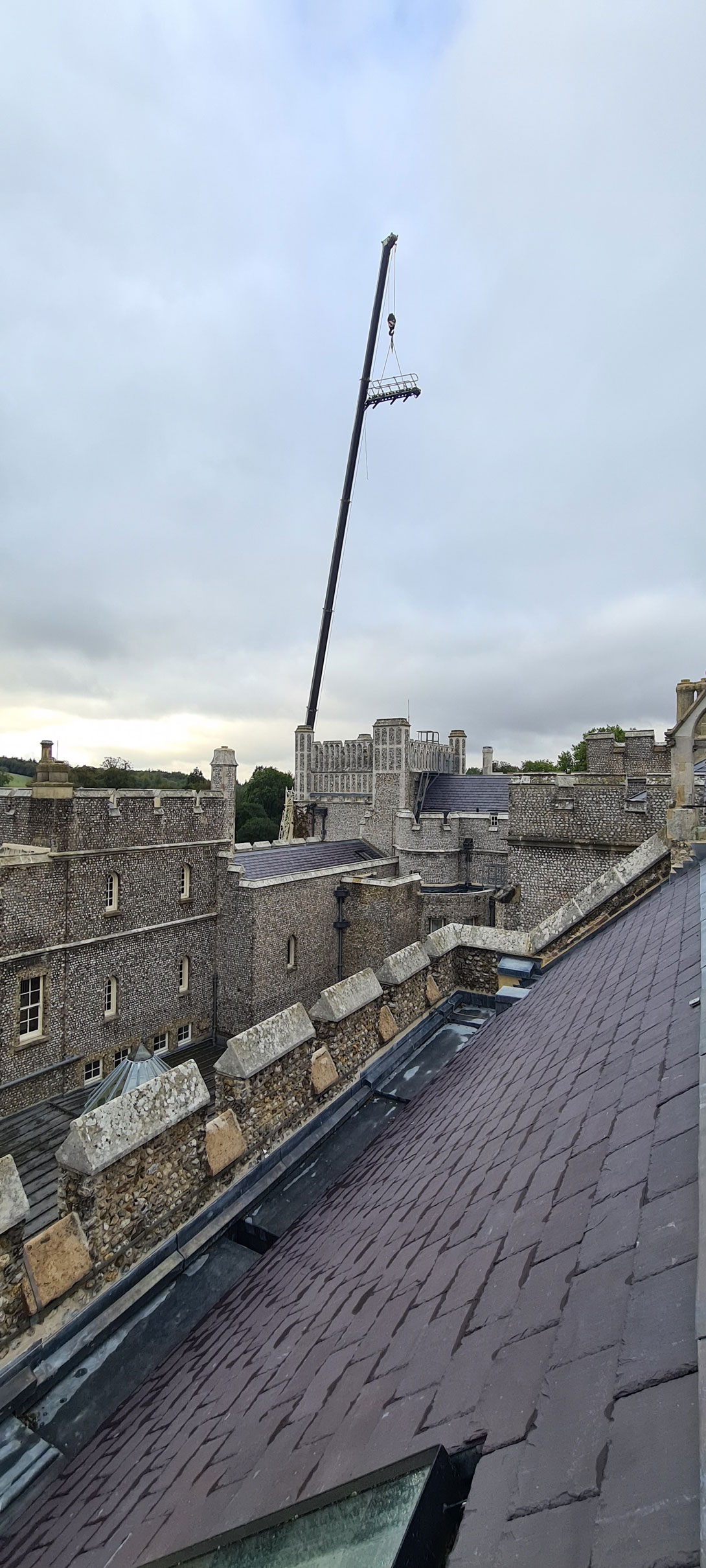 Crane lifting Step Unit and placing it on college roof