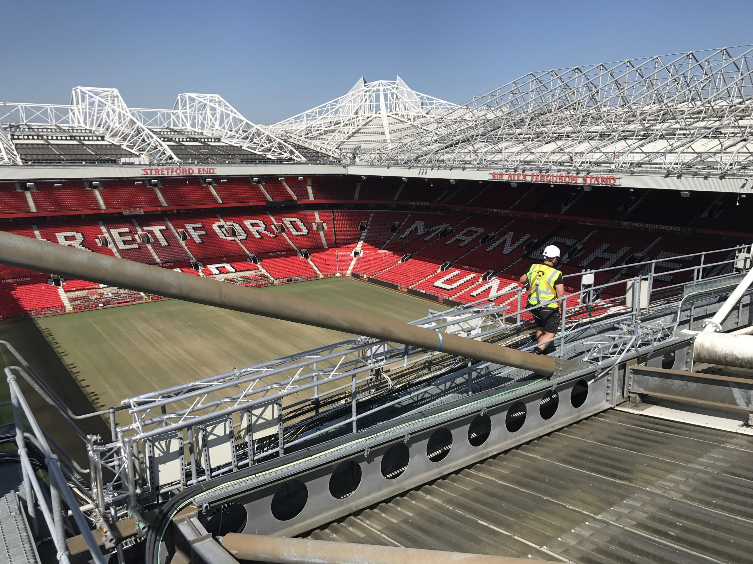 Heightsafe operatives complete compliance inspections on the roof of the stands at Old Trafford