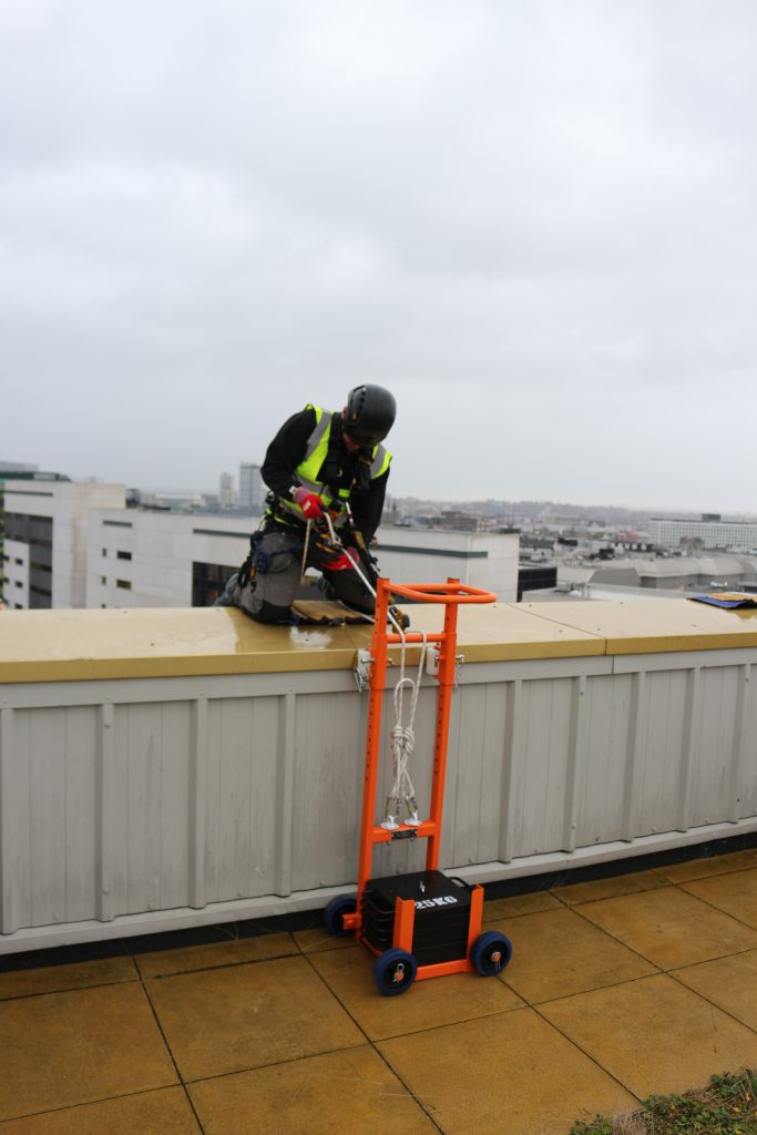 Heightsafe Dead Weight Access Trolley for facade access site operative using the trolley