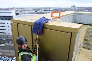 Heightsafe rope access operative using dead weight trolley system for facade access